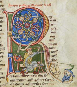 Manuscrit médiéval montrant un moine écrivant